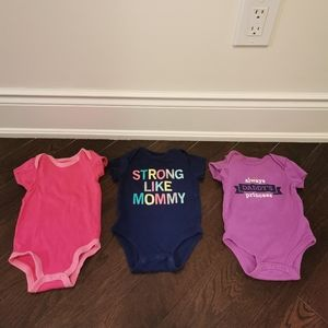 Assortment of baby onesies